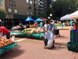 Warm weather brought refreshing change to Main Street as the Farmers Market relocated temporarily to Good Shepherd Plaza.